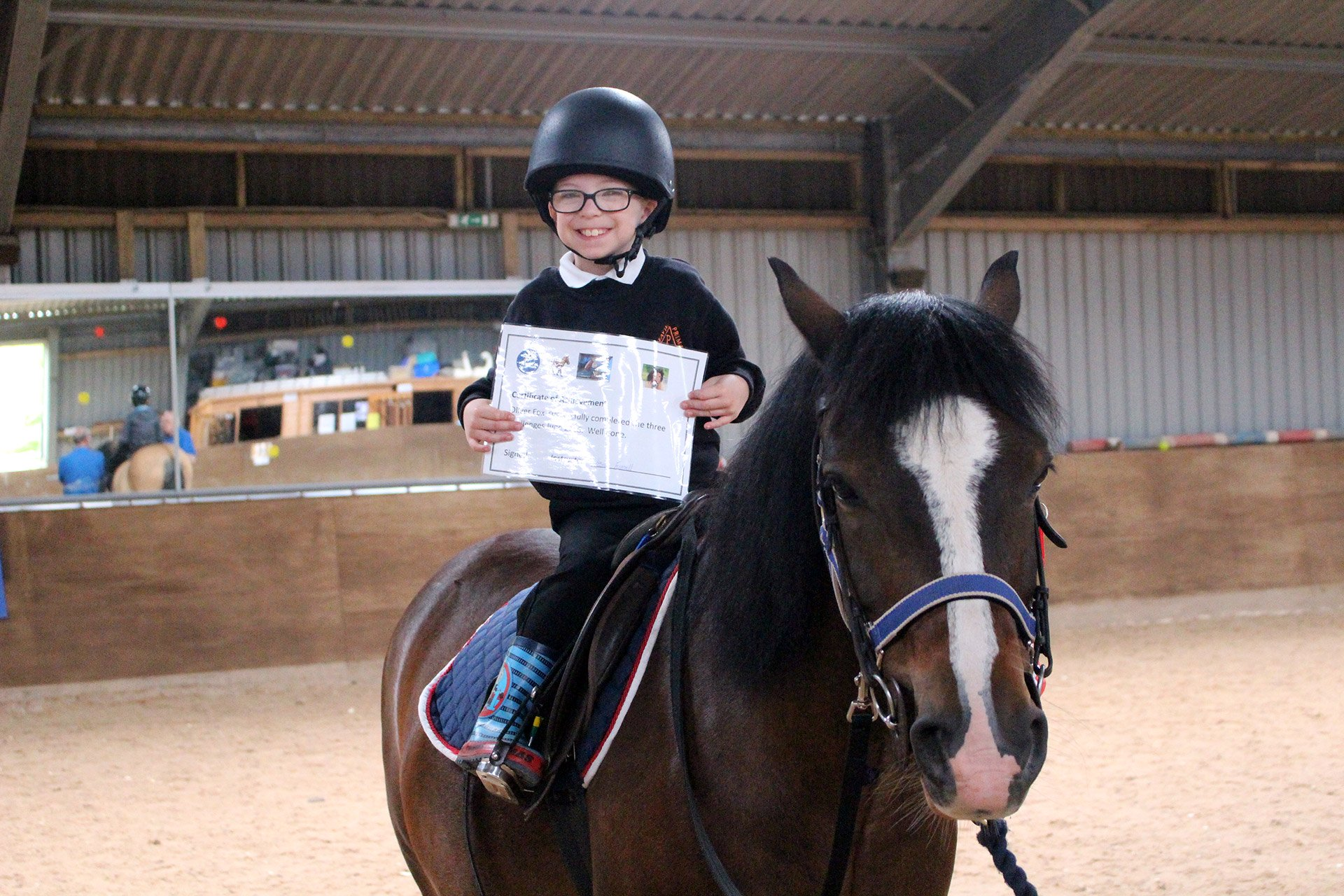 Therapeutic riding by trained coaches